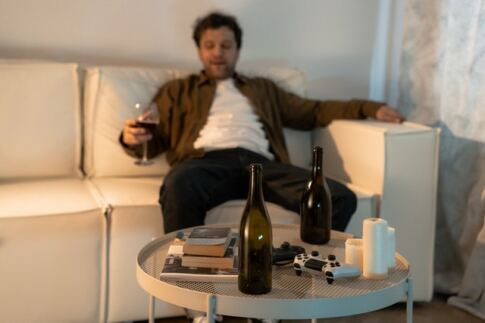 How to Increase Testosterone Naturally, drunk man sitting on a sofa