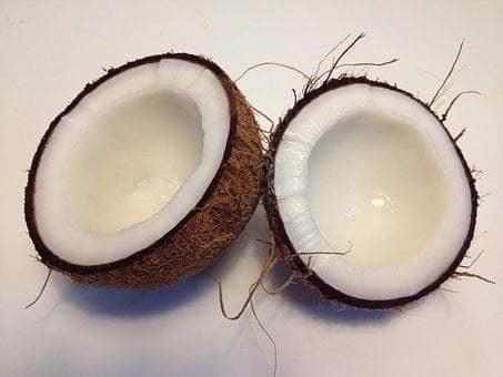 Coconut oil benefits for men, coconut split in half
