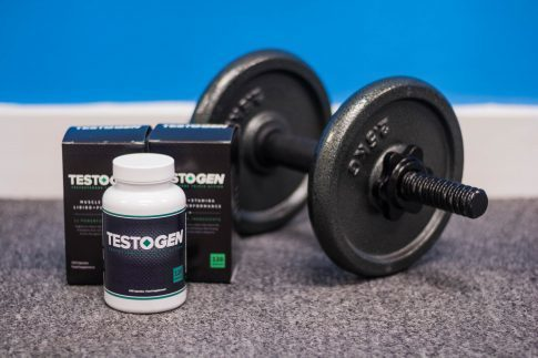 TestoGen scam, several bottles of TestoGen next to a dumbbell