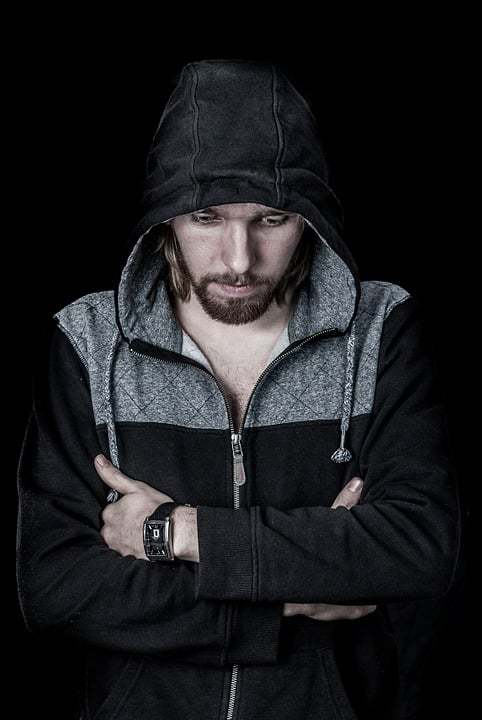 Things that lower testosterone levels, man in a hoodie looking down