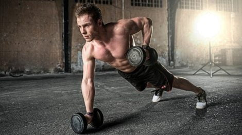 Will a testosterone booster help build muscle, man working out