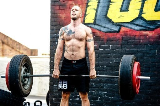 Can deadlifts increase testosterone, man lifting bar with tires on it