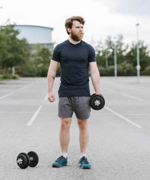 What is Free Testosterone, confused man holding a dumbbell in his left hand