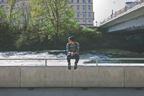 Does Testosterone Make You Taller, boy sitting next to a river