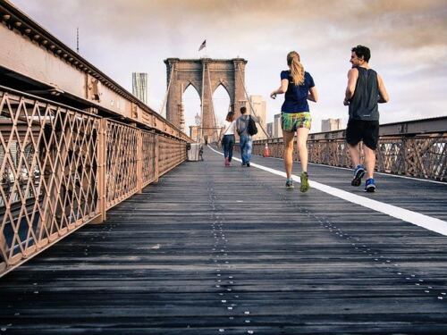Here's How and If 30-Day Fitness Challenges Really Work, male and female running partners